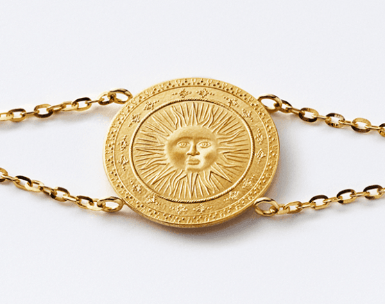 Sun motif in gold
