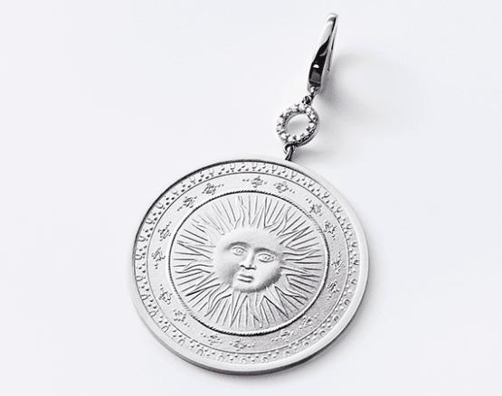 Sun motif in silver